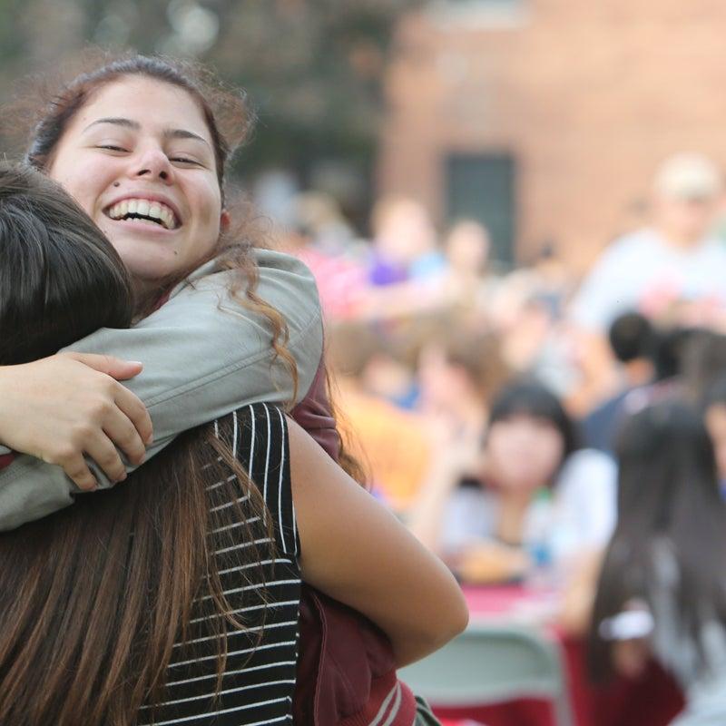 Two RPI girls hugging